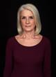 Senior blonde woman isolated on black