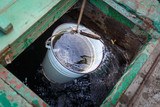 Full bucket of clear water got out of a deep well - 232770021