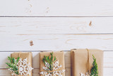 Homemade wrapped christmas gift box presents on a wood table background. - 232776013