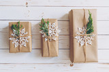 Homemade wrapped christmas gift box presents on a wood table background. - 232776027