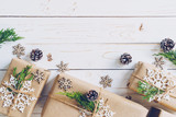 Homemade wrapped christmas gift box presents on a wood table background. - 232776048
