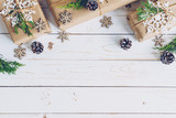 Homemade wrapped christmas gift box presents on a wood table background. - 232776059