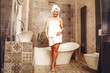 Leinwanddruck Bild - slim young woman in bathroom and white towel
