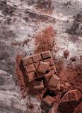 Broken chocolate pieces and cocoa powder - 232777490