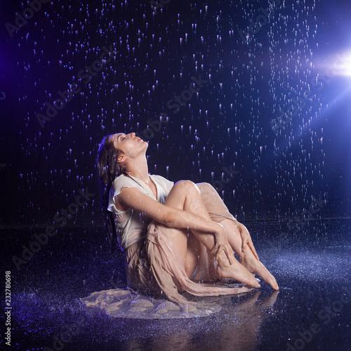Fridge magnet Girl sitting in the rain, night concept.