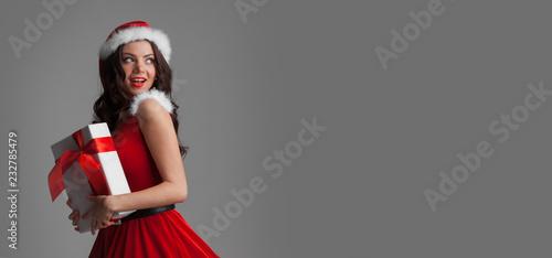 Foto Murales Woman in santa dress with gift