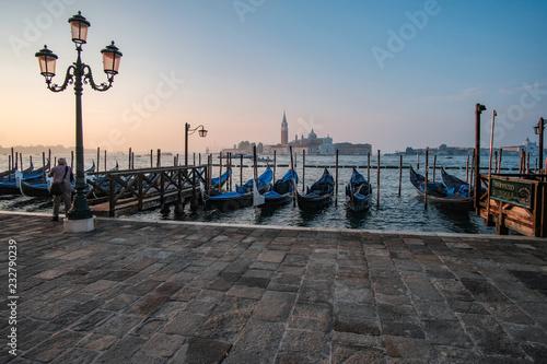 fototapeta na ścianę Venice, Italy, September 17, 2018 - Tourist take pictures sunrise on the waterfront next to the Doge Palace