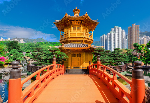 obraz PCV The Golden pavilion and gold bridge in Nan Lian Garden near Chi Lin Nunnery, famous landmark in Hong Kong