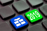 2019 and a gift icon written on a computer keyboard - 232797054