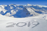 2019 written in the snow, mountain landscape in the background - 232800878
