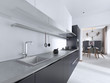 Leinwandbild Motiv Luxurious Contemporary kitchen with gray matte furniture in white interior.