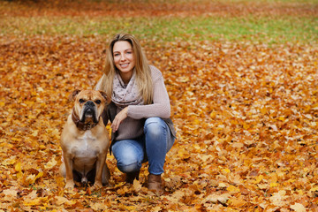 Middle age woman with her dog enjoying the autumnal nature © absolutimages