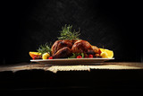 Baked turkey or chicken. The Christmas table is served with a turkey, decorated with fruits, salad and nuts. Fried chicken, table. Christmas dinner - 232840275