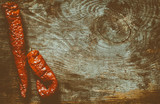 Pod of red chili pepper on vintage wood background - 232847640