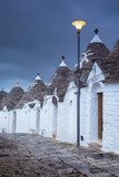 gray twilight above truly houses in Alberobello in Italy - 232848063