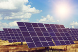 solar panels on the sky background - 232856258