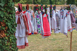 Old traditional Romanian folk costumes with embroidery - 232863813
