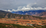 Beautiful landscape with mountains, agricultural fields and small village at the foot of the mountains. China. Travel Asia. - 232867865