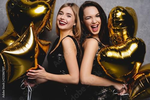 Party Fun. Beautiful Girls Celebrating New Year. Portrait Of Gorgeous Smiling Young Women Enjoying Party Celebration, Having Fun Together. High Quality Image. © opolja