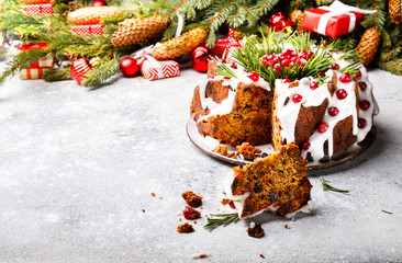 Christmas fruit cake, pudding on gray background. New Year pastries Holidays Concept Copy space for Text..
