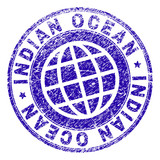 INDIAN OCEAN stamp imprint with grunge style. Blue vector rubber seal imprint of INDIAN OCEAN label with unclean texture. Seal has words arranged by circle and planet symbol. - 232883403