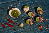 Bourgogne Escargot Snails with garlic herbs butter on the blue surface. Healthy food concept with copy space. - 232883444