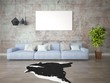Mock up fashionable living room with a large comfortable sofa and hipster backdrop.
