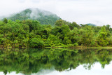 Beautiful landscape of peaceful lake and mountain in deep jungle in Thailand after the rain. - 232891064