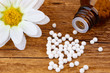Homeopathy medicine with blossom of a flower