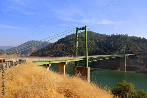 susupension bridge crossing a lake