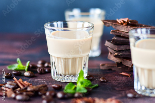 Poster strong coffee liqueur with coffee beans, chocolate chips and dark chocolate pieces