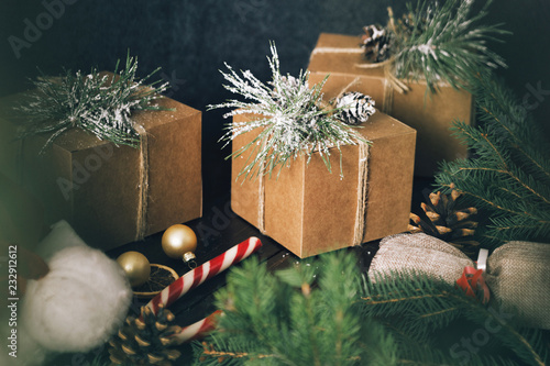 Christmas ornaments gift boxes wooden table Rustic Christmas background Wrapping presents © kucherav