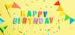 Birthday concept - candles with letters 'happy birthday' and confetti