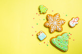 Christmas cookies on bright yellow background - 232914022