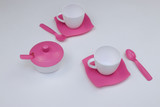 children's toy dishes for tea on a white background - 232915231