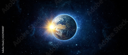 Panoramic view of the Earth, sun, star and galaxy. Sunrise over planet Earth, view from space. Elements of this image furnished by NASA © Tryfonov