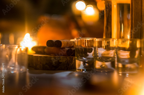 Cigar and rhum rum to end the night in friednship with men's things related. Bokeh and defocused image for conceptual mood about males