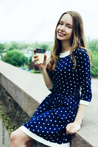 Poster girl with disposable cup