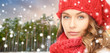 holidays, christmas and people concept - young woman in knitted hat and scarf over winter forest and snow background