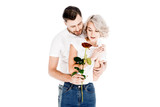Beautiful couple with flower hugging while man giving to woman red flower isolated on white - 232947222