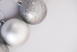 White Christmas background. Glossy silver and glitter decoration balls. Minimalist style. Copyspace for text, overhead - 232947233