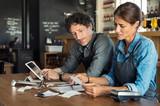 Staff calculating restaurant bill - 232957208
