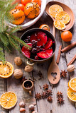 The process of preparing mulled wine. Traditional Christmas drink. - 232957436