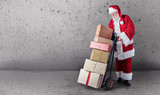Santa with gifts, delivery trolley and copy space © exclusive-design