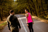 Athletic couple running together on the forest trail © Boggy