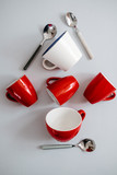 Christmas tree made of red coffee cups and spoons. Creative flat lay, minimalism concept - 232980405