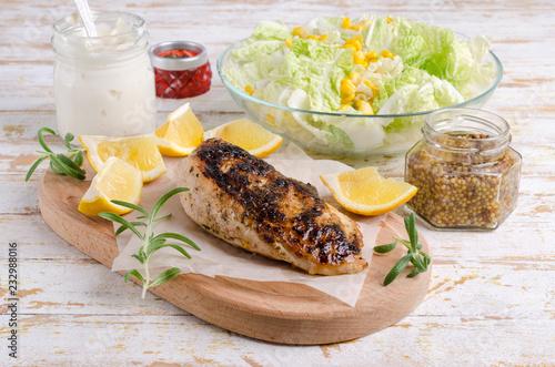 Leinwandbild Motiv Fried chicken breast with spices