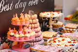 Delicious candy bar with cakes, cake pops, coucakes and other sweets - 232990865