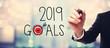 Leinwanddruck Bild - 2019 Goals with businessman on blurred abstract background
