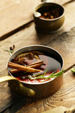 mulled wine with cinnamon and orange on a wooden background - 233001273